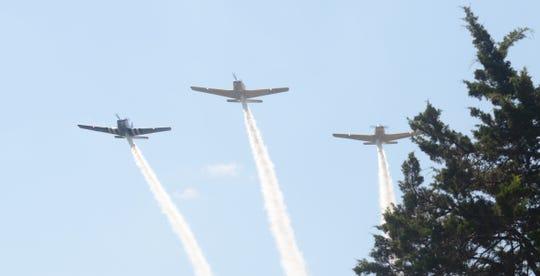 The Hooligans Flight Team makes a pass on Thursday.