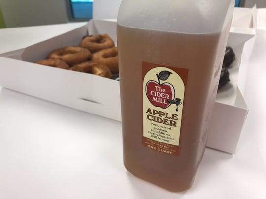 Cider and doughnuts purchased on the opening day of the Cider Mill on Aug. 1.