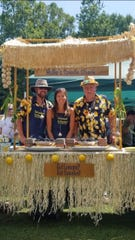 From left: Arlo Isom, Hollie Malinovsky Isom and Dave Malinovsky compete in the Spiedie Cooking Contest each year.