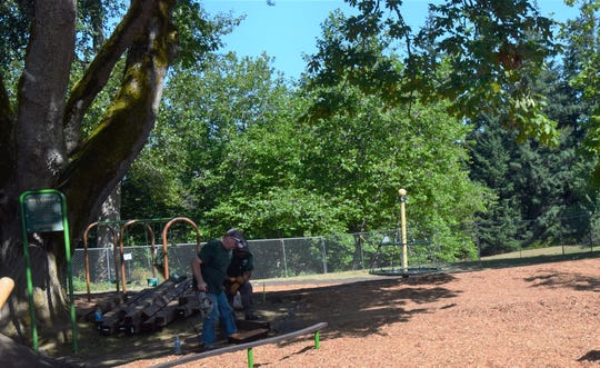 FILE — Kitsap County Parks Department employees install a retaining wall at the Buck Lake Park playground in 2019.