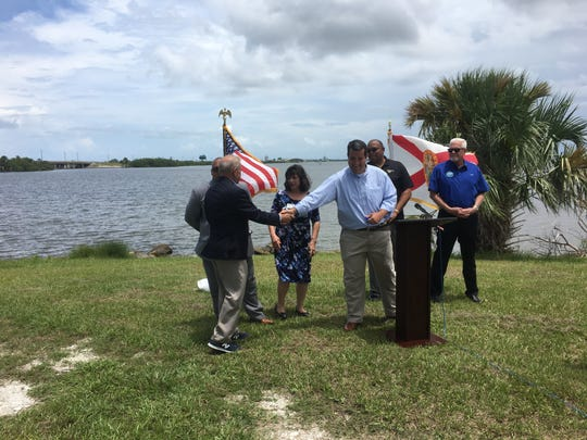 Florida House Rep. Tyler Sirois shakes hands Thursday with Brevard County Commissioner Curt Smith at a press conference at Kelly Park on Merritt Island. Sirois announced his proposal to change Port Canaveral's state charter to require the port set aside 2% of its gross revenue for Indian River Lagoon environmental cleanups.