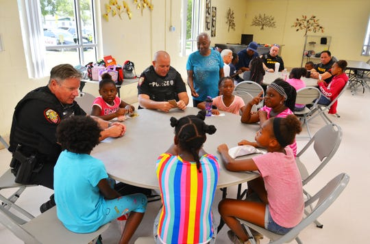Melbourne police officers stopped by to visit kids attending camp at the Lipscomb Community Center in Melbourne. Officers Mark Lang and Charles McClure, Lt. John Grinwis and Sgt. Jeff Rau visit with some children before lunch. Aug. 6 is National Night Out and Lipscomb Community Center is one of the four stops Melbourne police will visit.