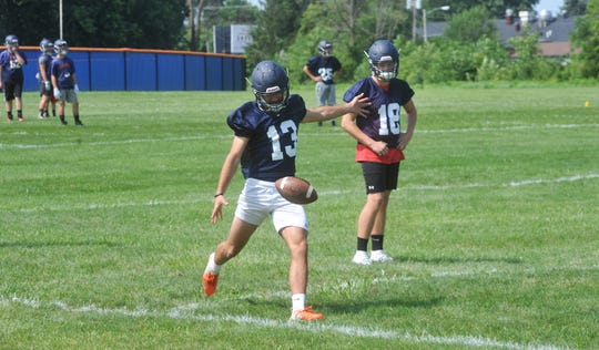 Galion worked on punting during the early part of its second practice of the day.