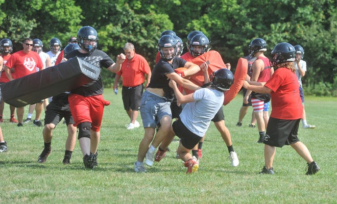Bucyrus ran some in-game practice plays with calls coming from the sideline.