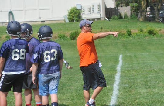 Coach Matt Dick instructs his players during the second practice of the day Thursday.