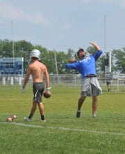 Wynford assistant Jordan Oliver helped the Royals work on fielding punts by lofting footballs up high.