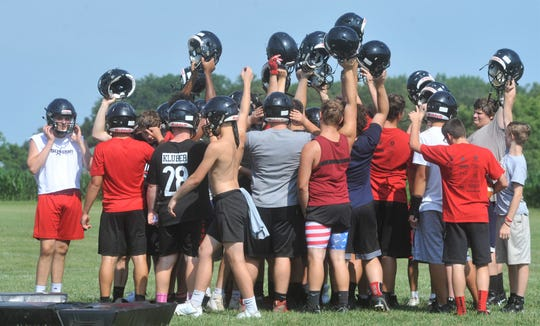 Bucyrus players huddle together in between drills Thursday morning.