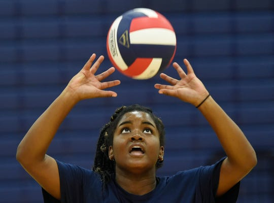 Junior Tierra Jackson prepares to pass the ball during a pepper drill at the Veterans Memorial volleyball tryouts, Thursday, August 1, 2019, at Veterans Memorial High School. Jackson was on the team last year.