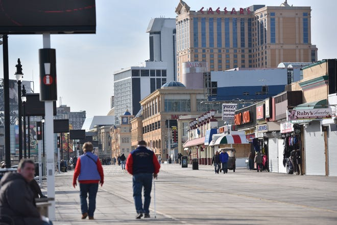 People stroll along the boardwalk in Atlantic City in 2018. Atlantic City police announced Thursday that they'll start strictly enforcing curfew for those under 18 to stem a recent surge in teen violence.