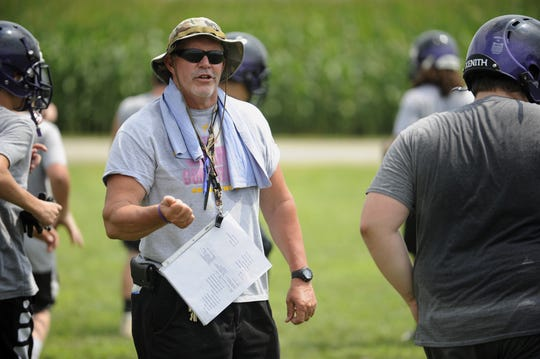 Unioto head football coach Jeff Metzler talks to players during the first day of two-a-days in August.