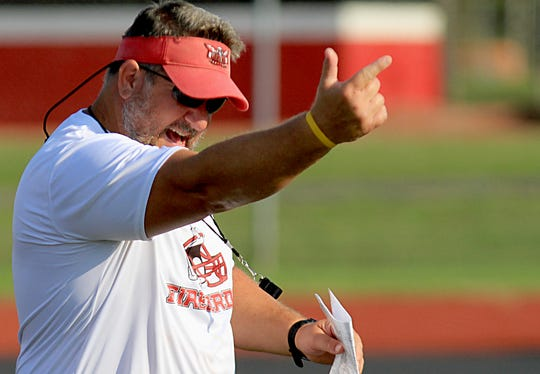 Lakota West head coach Tom Bolden oversees practice during the first day of football practice at the school in West Chester Township Thursday, Aug. 1, 2019.
