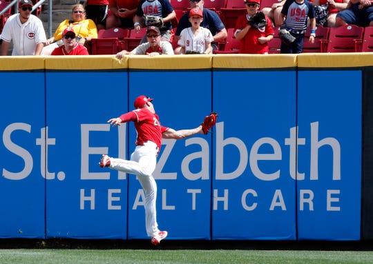 Jul 31, 2019; Cincinnati, OH, USA; Cincinnati Reds right fielder Michael Lorenzen (21) fields a fly ball against the Pittsburgh Pirates during the ninth inning at Great American Ball Park.