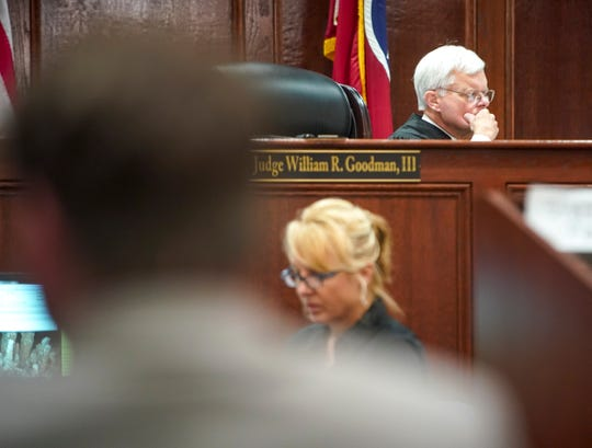 Judge William R. Goodman III reads his notes during the verdict delivery for a 2017 case involving bounty hunters at Montgomery County Court in Clarksville on Thursday, Aug. 1, 2019.