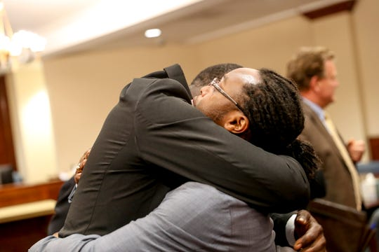 Joshua Young and Prentice Williams embrace one another after the verdict delivery for a 2017 case involving bounty hunters at Montgomery County Court in Clarksville, Tenn., on Thursday, Aug. 1, 2019.