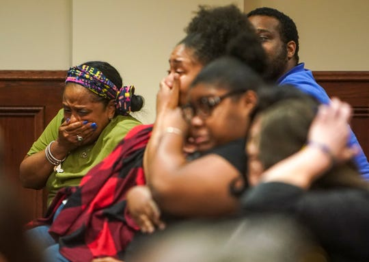 Family and friends cry in joy when defendants are delivered many not-guilty verdicts during the verdict delivery for a 2017 case involving bounty hunters at Montgomery County Court in Clarksville, Tenn., on Thursday, Aug. 1, 2019.
