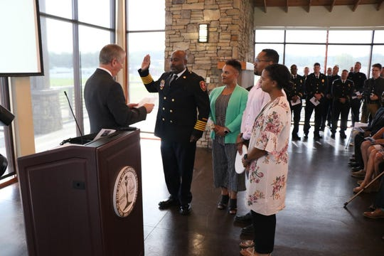 Clarksville Mayor Joe Pitts swears in Fire Chief Freddie Montgomery Jr. on Thursday, Aug. 1, 2019.