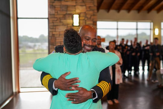 Incoming Clarksville Fire Rescue Chief Freddie Montgomery Jr. is congratulated by his wife, Priscilla, after she pinned his badge on him Thursday, Aug. 1, 2019.