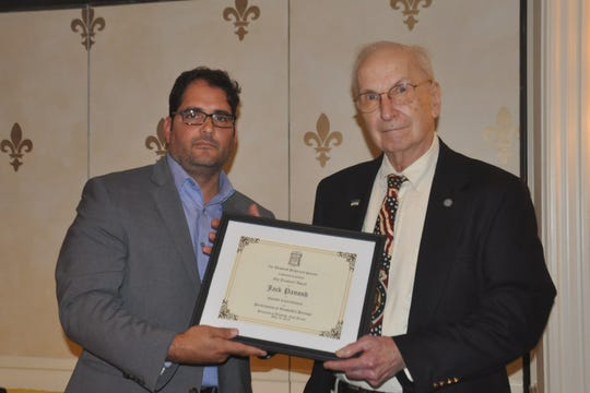 Jack Panosh (right) is presented the 2019 Trustees Award by Greg Blasi during the 51st Annual Dinner of the Westfield Historical Society held on Friday, May 10.