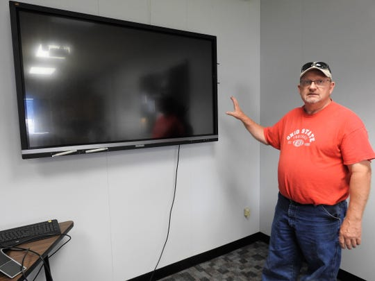 Bart Winegar, Director of Technology at the Coshocton County Career Center, explains usage of a new interactive touch screen monitor which allows for internet use, students to interact from their desk and more.