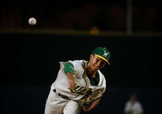 Iowa City West sophomore Marcus Morgan fires a pitch against Pleasant Valley in Class 4A baseball at Principal Park on Wednesday, July 31, 2019, in Des Moines.