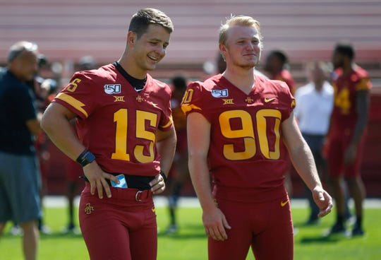 Iowa State sophomore quarterback Brock Purdy, left, and freshman place kicker Brayden Narveson talk on the field prior to team photos during Iowa State football's media day on Thursday, Aug. 1, 2019, at Jack Trice Stadium in Ames.