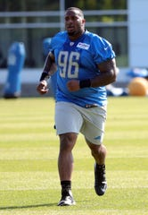 Lions defensive tackle Mike Daniels runs during practice during training camp on Thursday, August 1, 2019, in Allen Park.