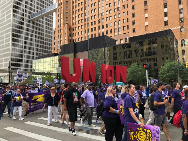 Members of SEIU marched to Campus Martius, specifically stopping across from SecurAmerica's headquarters, to show solidarity with union workers July 31, 2019.