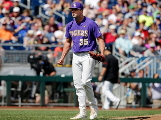 LSU's Alex Lange reacts during the seventh inning of a College World Series game in Omaha, Neb., June 23, 2017.