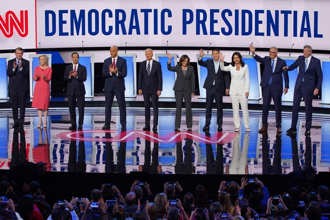 Candidates take the stage before the start of the second night of the Democratic presidential debates at the Fox Theatre in Detroit on Wednesday, July 31, 2019.