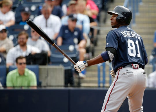 Atlanta Braves' Travis Demeritte bats during a spring training game March 12, 2017 in Tampa, Fla.