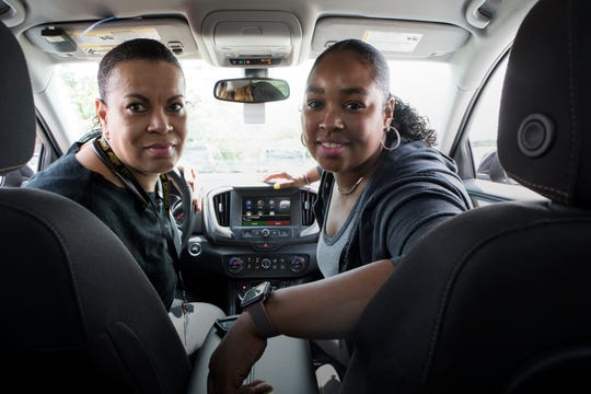 From left, Sharon Williams, 55 of Centerline and Teana Dowdell, 34 of Troy carpool together daily to their job at GM's Flint Assembly plant from this Park & Ride on N Adams Rd in Bloomfield Hills, Mich., Wednesday, July 24, 2019.