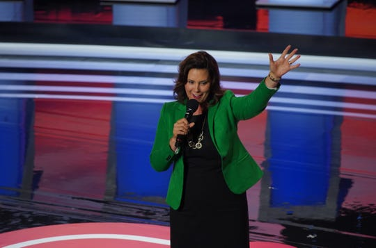 Michigan Governor Gretchen Whitmer takes the stage before the first night of the Democratic presidential debates at the Fox Theatre in Detroit on Tuesday, July 30, 2019.