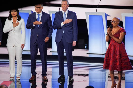 The National Anthem is sung during the second night of the Democratic presidential debates at the Fox Theatre in Detroit on Wednesday, July 31, 2019.