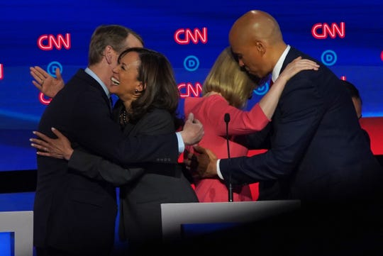 Democratic presidential candidates congratulate each other at the end of the second night of the Democratic presidential debates at the Fox Theatre in Detroit on Wednesday, July 31, 2019.