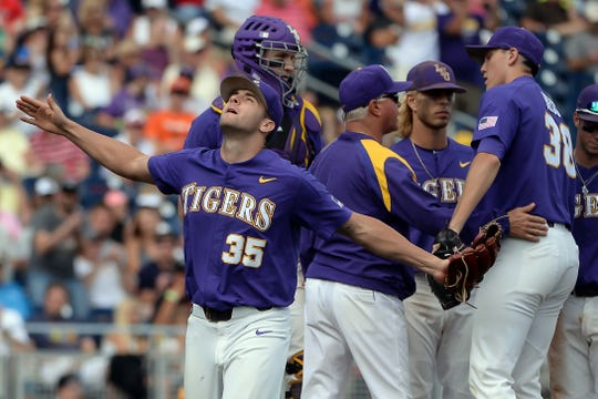 LSU pitcher Alex Lange (35) reacts after being removed in the eighth inning of a College World Series game in Omaha, Neb., June 23, 2017.