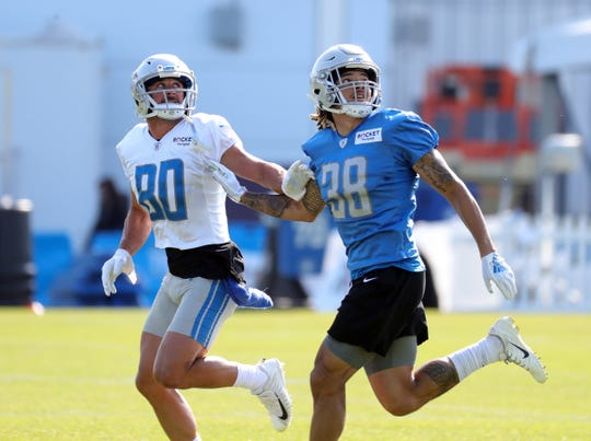 Lions defensive back Mike Ford, right, defends against receiver Danny Amendola during practice during training camp on Thursday, August 1, 2019, in Allen Park.