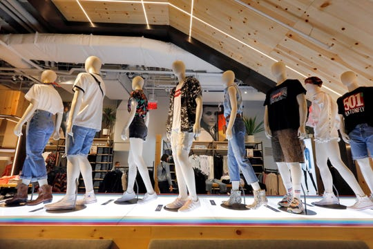 Mannequins display Levi's products on the lower level of the Levi's store in the New York's Times Square.
