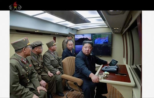 In this image made from video of a still image broadcasted by North Korea's KRT on Thursday, Aug. 1, 2019, North Korean leader Kim Jong Un supervises a rocket launch test .