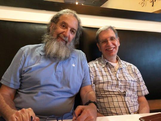 Stony Brook University journalism professor Jonathan Sanders, left, and associate dean of the Stony Brook journalism department Charles Haddad, right.