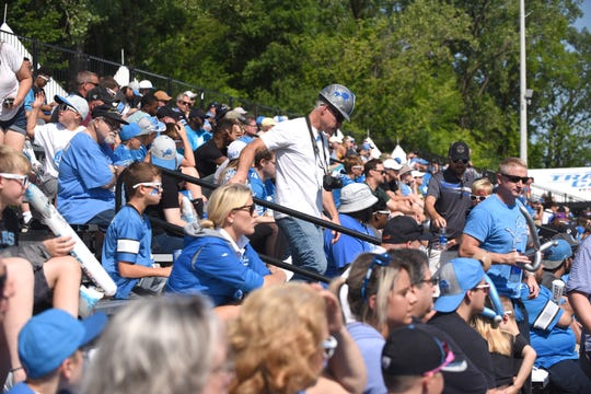 Detroit Lions fans watch practice on Thursday in Allen Park.