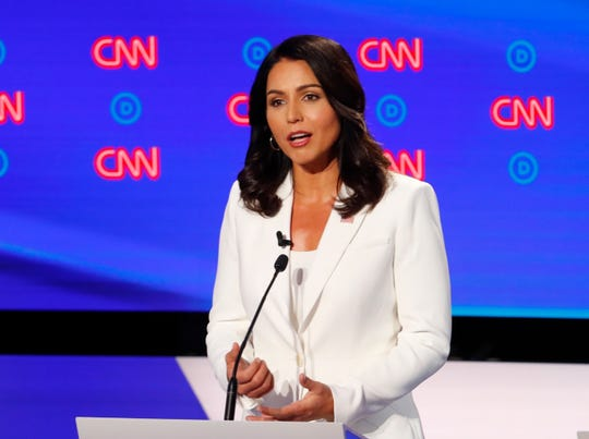 Rep. Tulsi Gabbard, D-Hawaii, speaks during the debate.