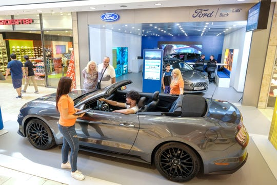 "Ford Motor Co. is testing small ""Smart Lab"" locations in malls outside the U.S. to help dealerships generate sales leads in new ways. This Smart Lab is in Saarbuken,  Germany."