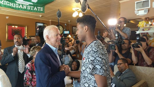 Former Vice President Joe Biden, left, greets 16-year-old James Heath of Detroit during a Thursday visit to Detroit One Coney Island.