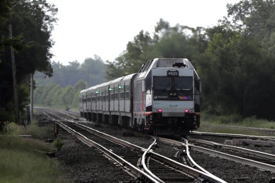 """This Aug. 3, 2018, file photo shows a New Jersey Transit train leaving the Bound Brook Station in Bound Brook, N.J. Federal railway officials say the railroad industry has installed safety technology on nearly 90 percent of tracks where it is required, but """"significant work"""" is needed to ensure the technology is completely installed by a December 2020 deadline."""
