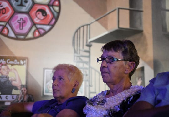 From left, Heather Hamilton, 71, and Claudia Seldon, 72, both of Detroit watch the debate at a watch party at the ACLU of Michigan in Detroit.