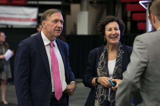 Former Stony Brook University President Samuel Stanley and Judith Greiman, senior vice president for government and community relations and chief deputy to the president, talk with someone at a campus event.