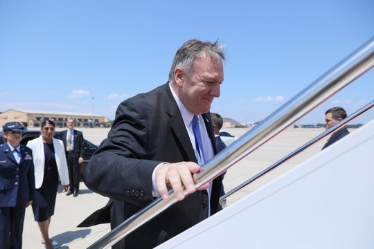 Secretary of State Mike Pompeo boards a plane at Andrews Air Force Base, Md., Tuesday, July 30, 2019.  Pompeo is heading to Thailand, Australia, and Micronesia.