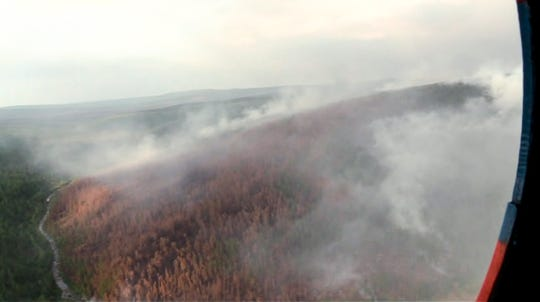 This image made from video provided by RU-RTR Russian television channel shows a view of a forest fire in the Boguchansky district of the Krasnoyarsk region, Russia Far East, Wednesday, July 31, 2019. Russian President Vladimir Putin has ordered Russia's military to join efforts to fight forest fires that have engulfed nearly 30,000 square kilometers (11,580 sq. miles) of territory in Siberia and the Russian Far East.