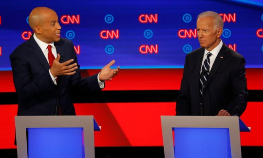 Sen. Cory Booker, D-N.J., gestures to former Vice President Joe Biden during the second of two Democratic presidential primary debates.