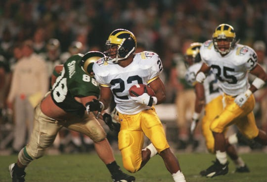 Ty Law makes an interception during Michigan's win over Colorado State in the 1994 Holiday Bowl.